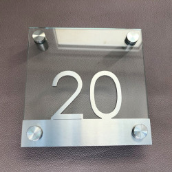 Brushed stainless steel and tempered-glass hotel or home plaque