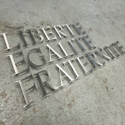 Custom mirror polished stainless steel sign